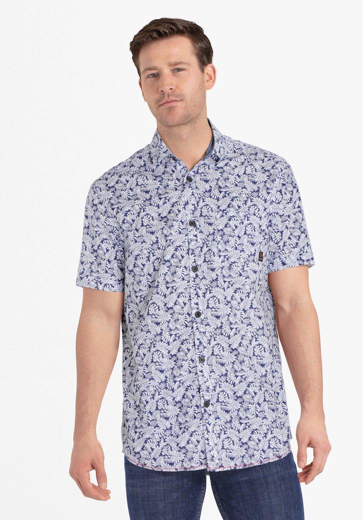 Chemise bleu marine à imprimé de feuilles blanches