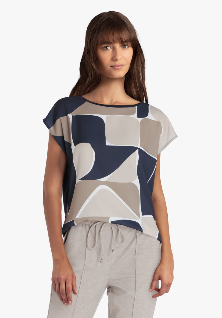 Donkerblauwe blouse met print in beige tinten