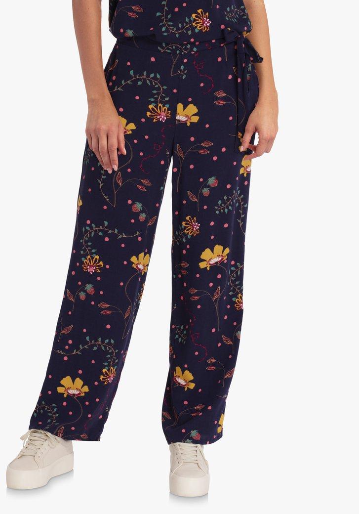 Donkerblauwe broek met bloemenprint en striklint