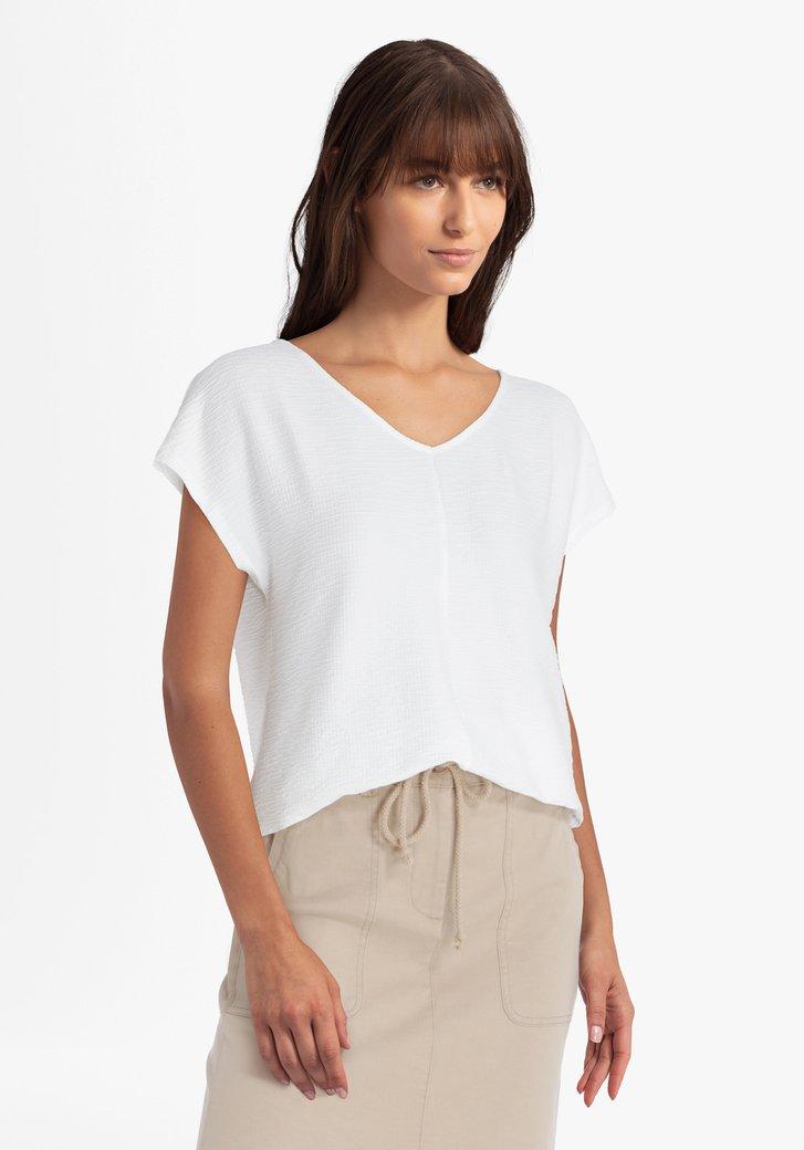 Ecru blouse in structuurstof