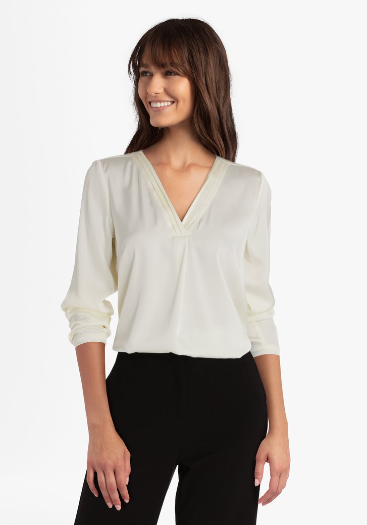Ecru blouse met V-hals