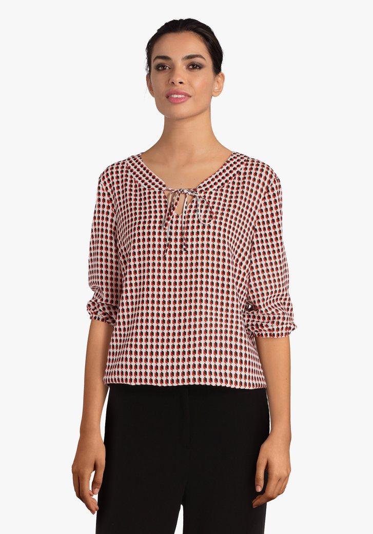 Ecru blouse met zwart-rode blokjes