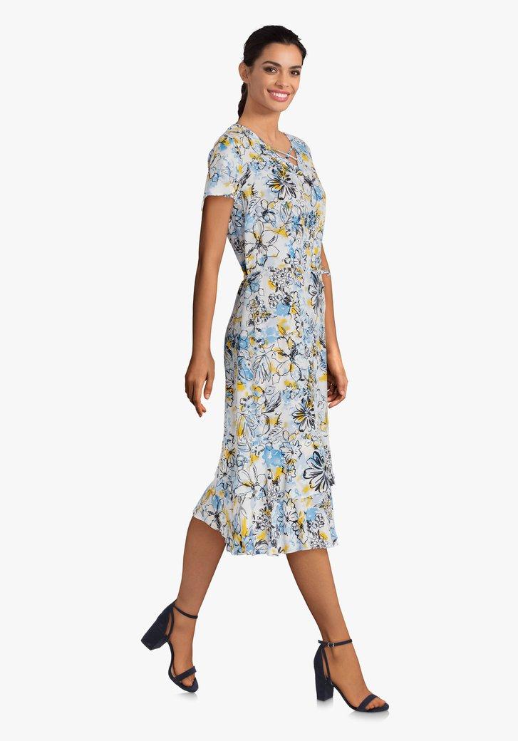 Ecru kleed met blauwe print en ruches