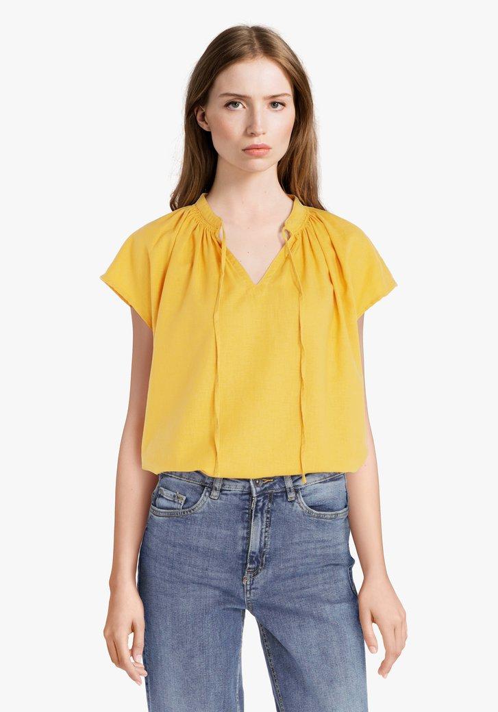 Gele blouse met linnen
