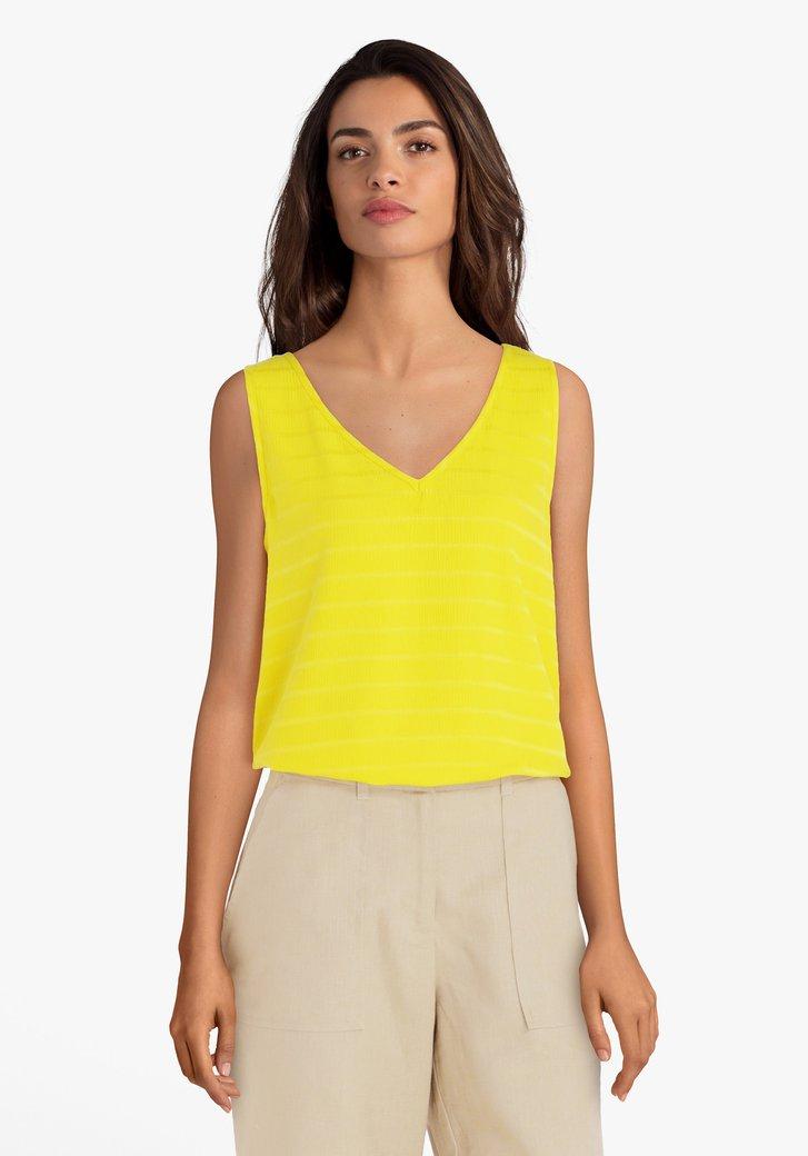 Gele blouse met reliëfdetails