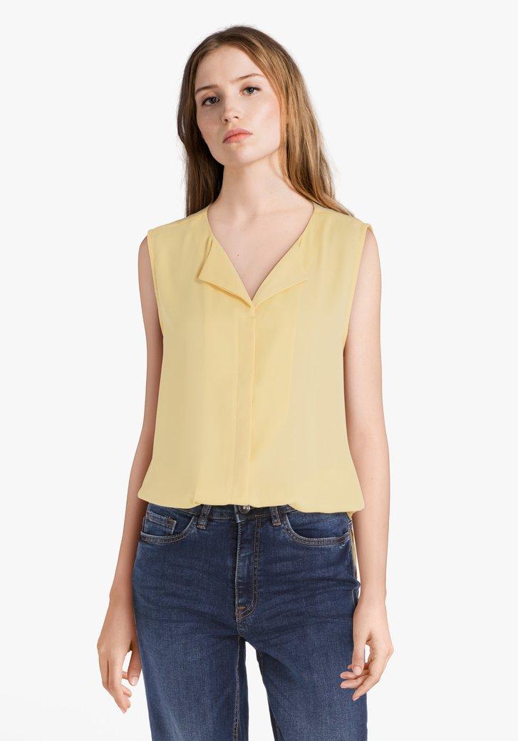 Gele blouse met verborgen knopenlijst