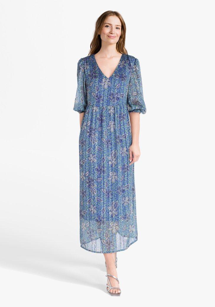 Groen kleed met blauwe bloemenprint