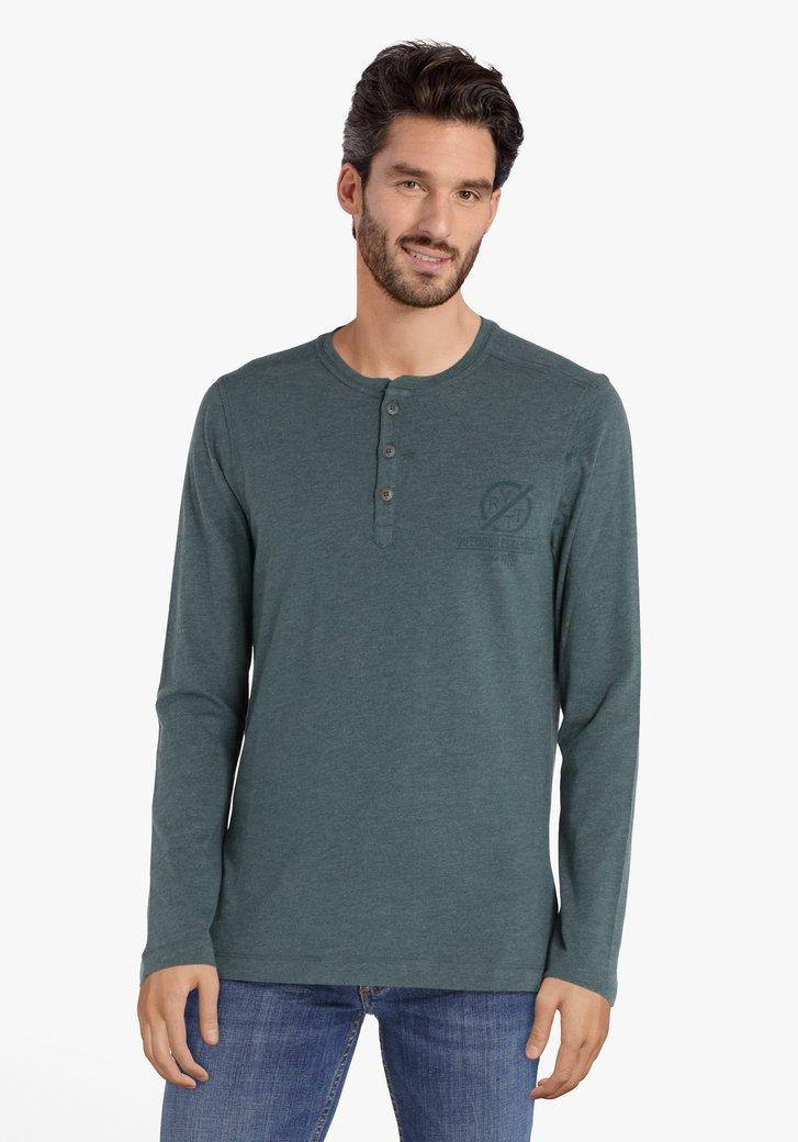 Groen T-shirt met zilverkleurige knopenlijst