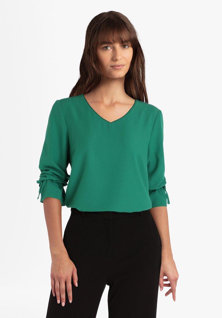Groene blouse met strikjes