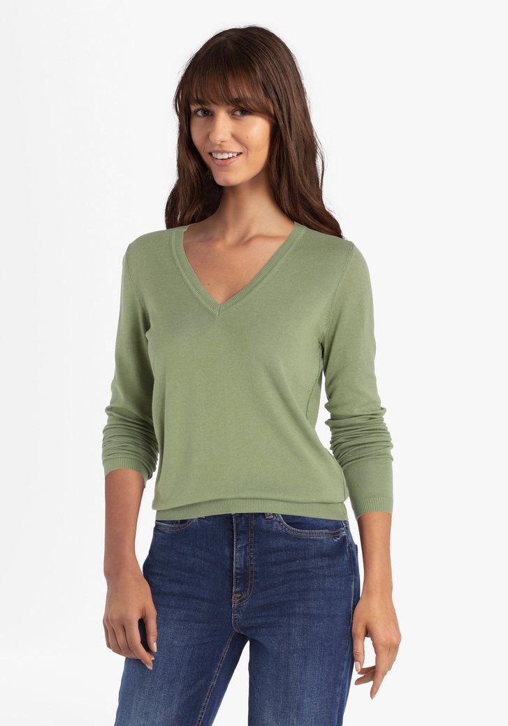 Groene trui met V-hals