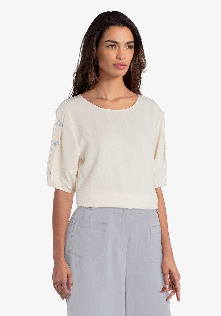 Lichtgele blouse met knopen op de mouwen