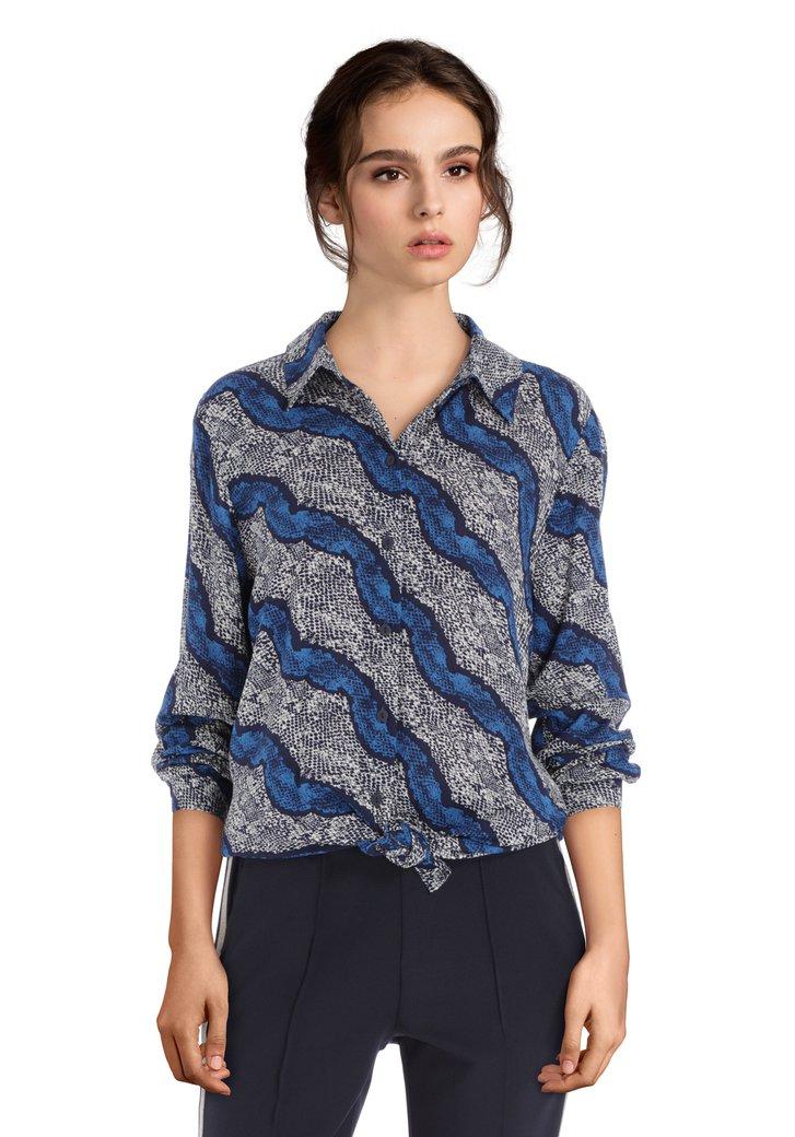 Afbeelding van Lichtgrijze blouse met donkerblauwe print