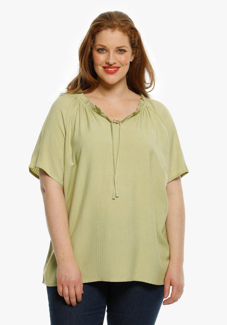 Lichtgroene blouse in structuurstof