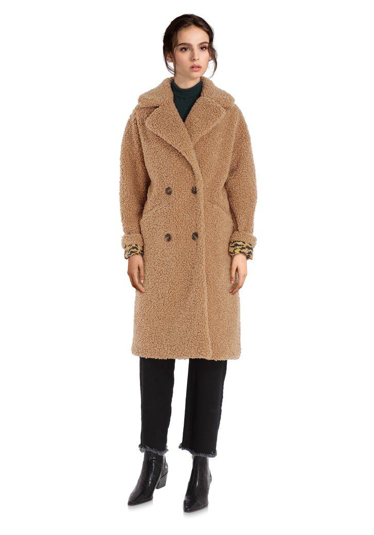 Manteau beige en bouclé