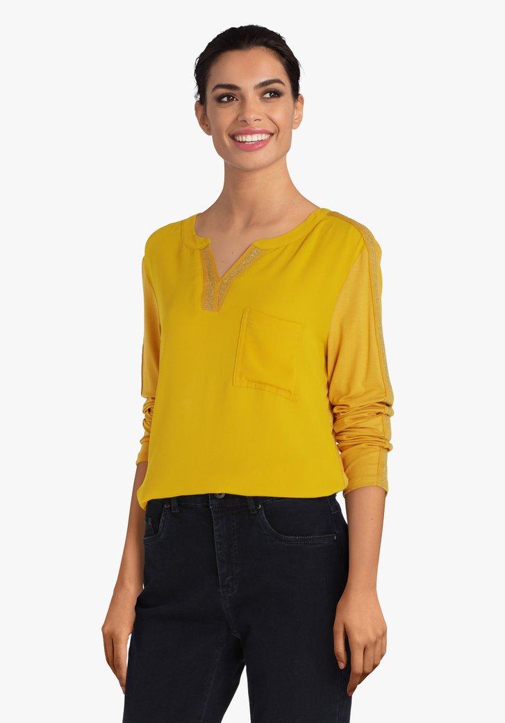 Okerkleurige blouse met glitter accent