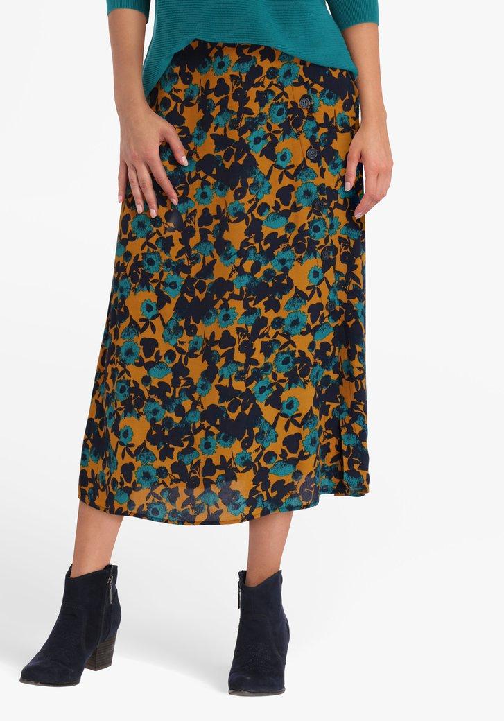 Okerkleurige rok met blauwe bloemen