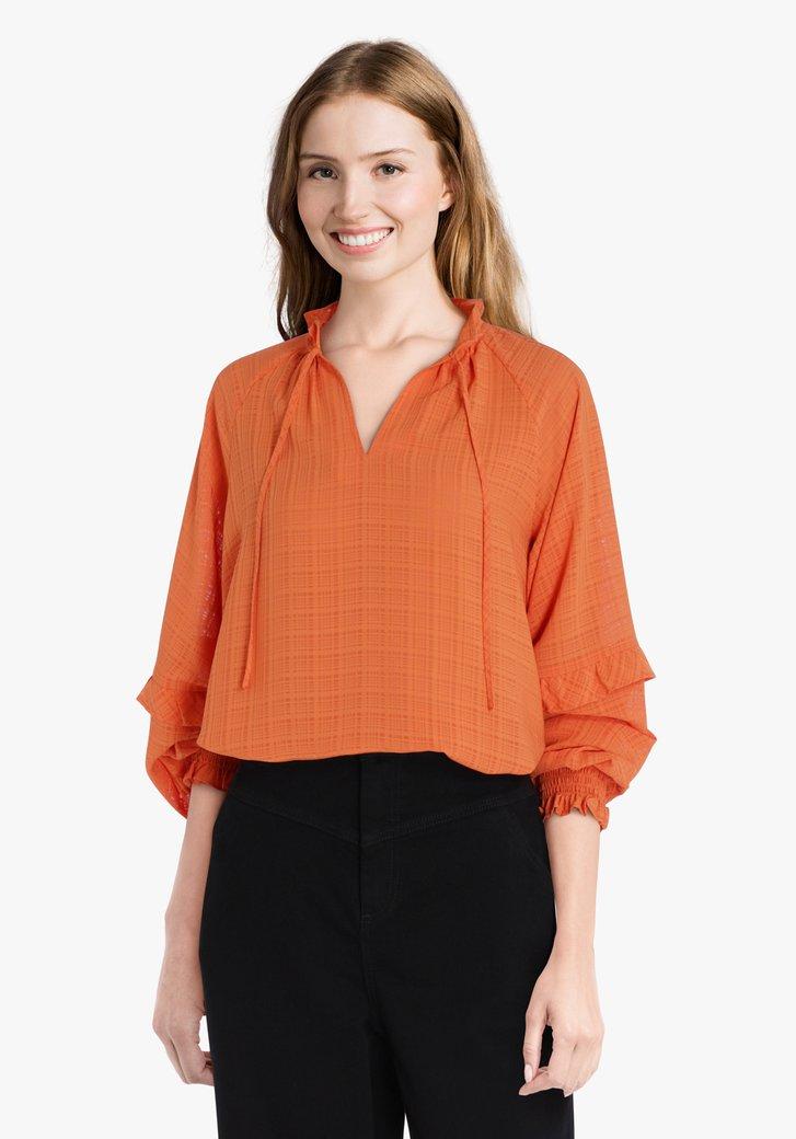 Oranje blouse in structuurstof