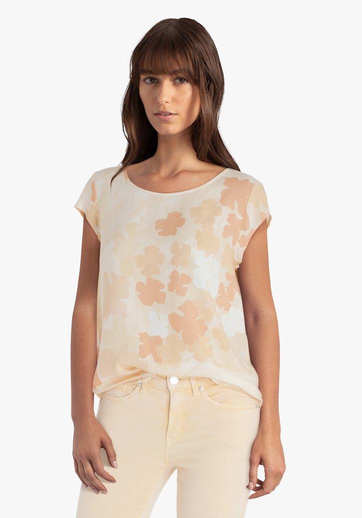 Oranje blouse met bloemen