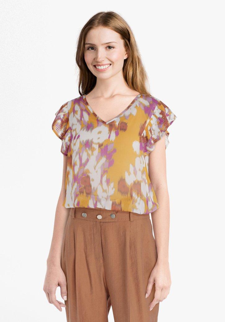 Oranje blouse met bloemenprint