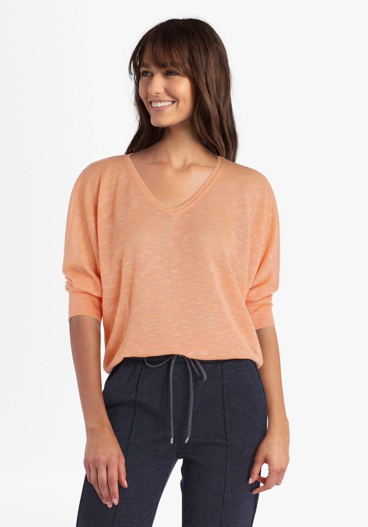 Oranje blouse met vleermuismouwen