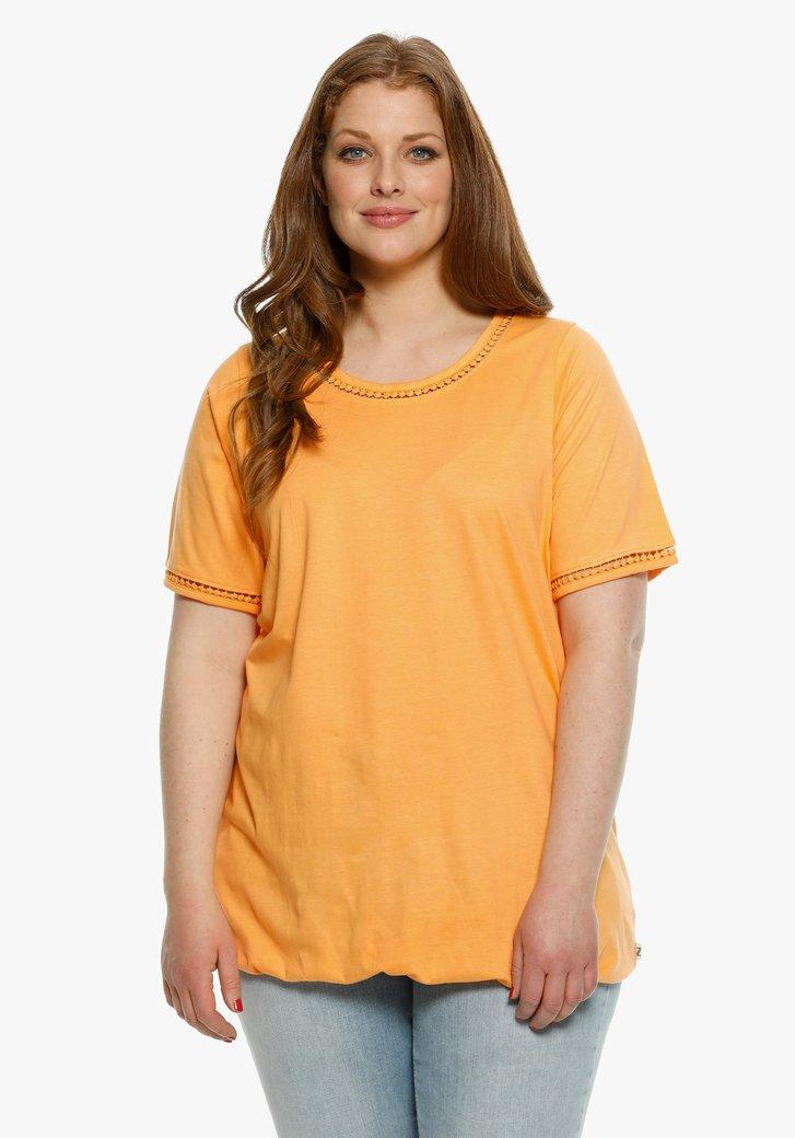 Oranje T-shirt met elastiek aan de taille