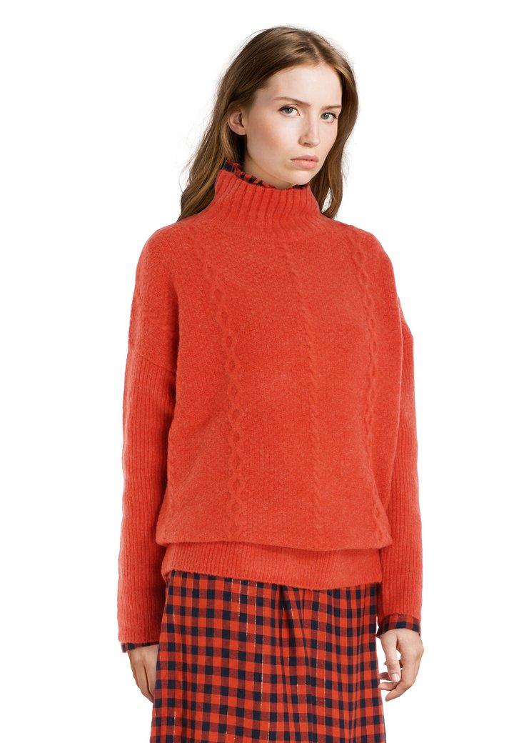 Oranje trui met kabelmotief