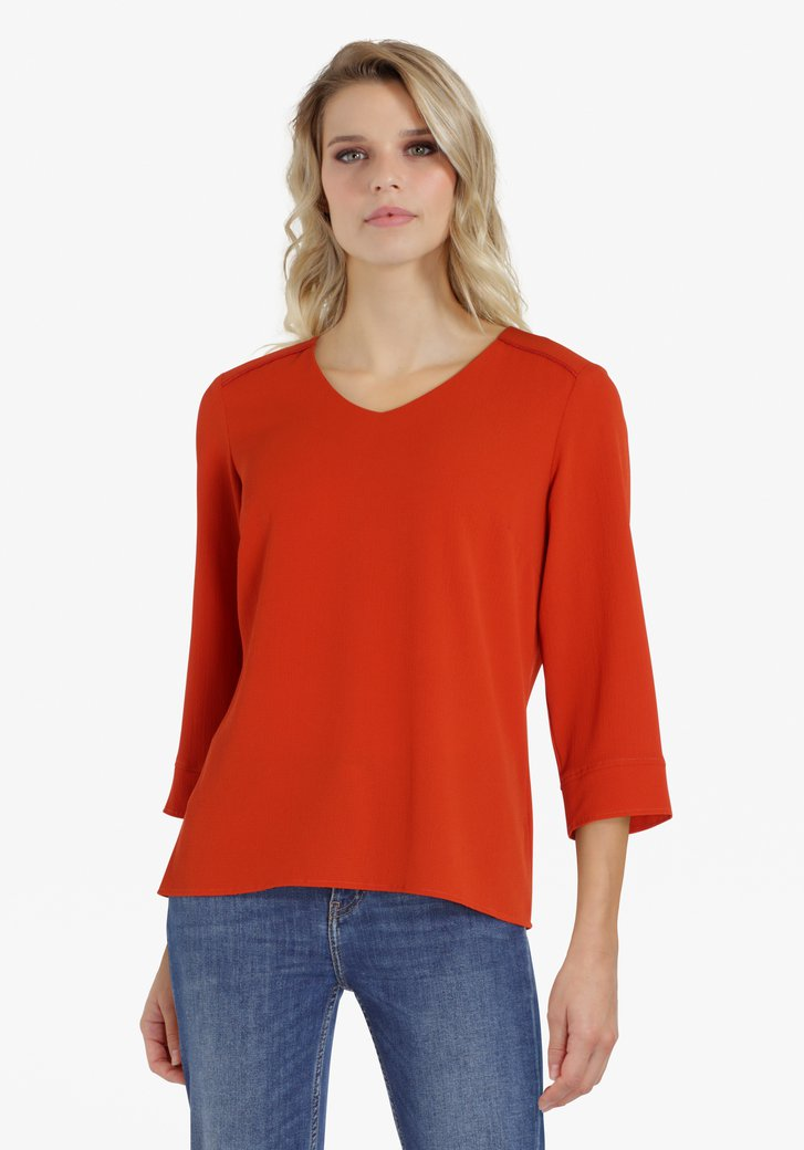 Oranjebruine blouse met V-hals