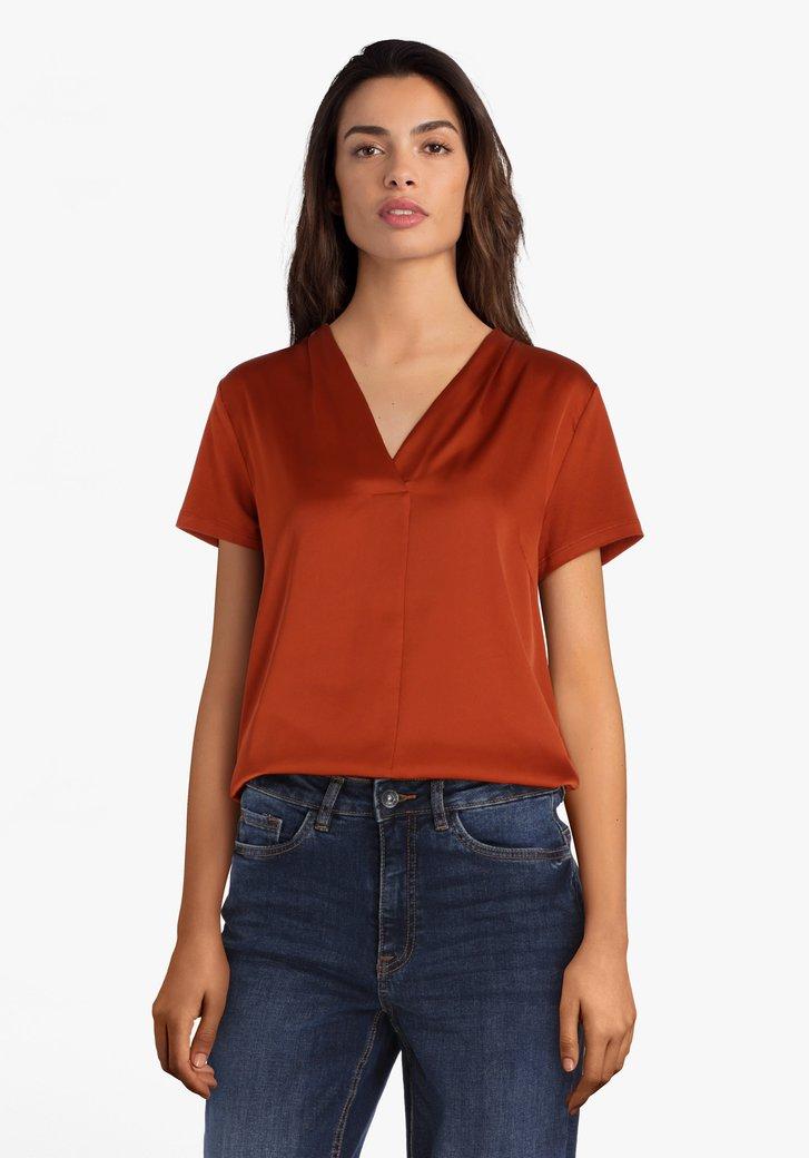 Oranjerode bloes met V-hals