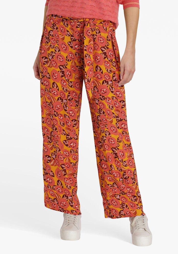 Oranjerode wijde broek met bloemenprint