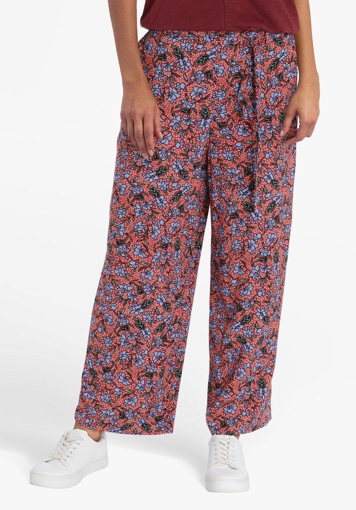 Pantalon brun rouge avec imprimé floral bleu