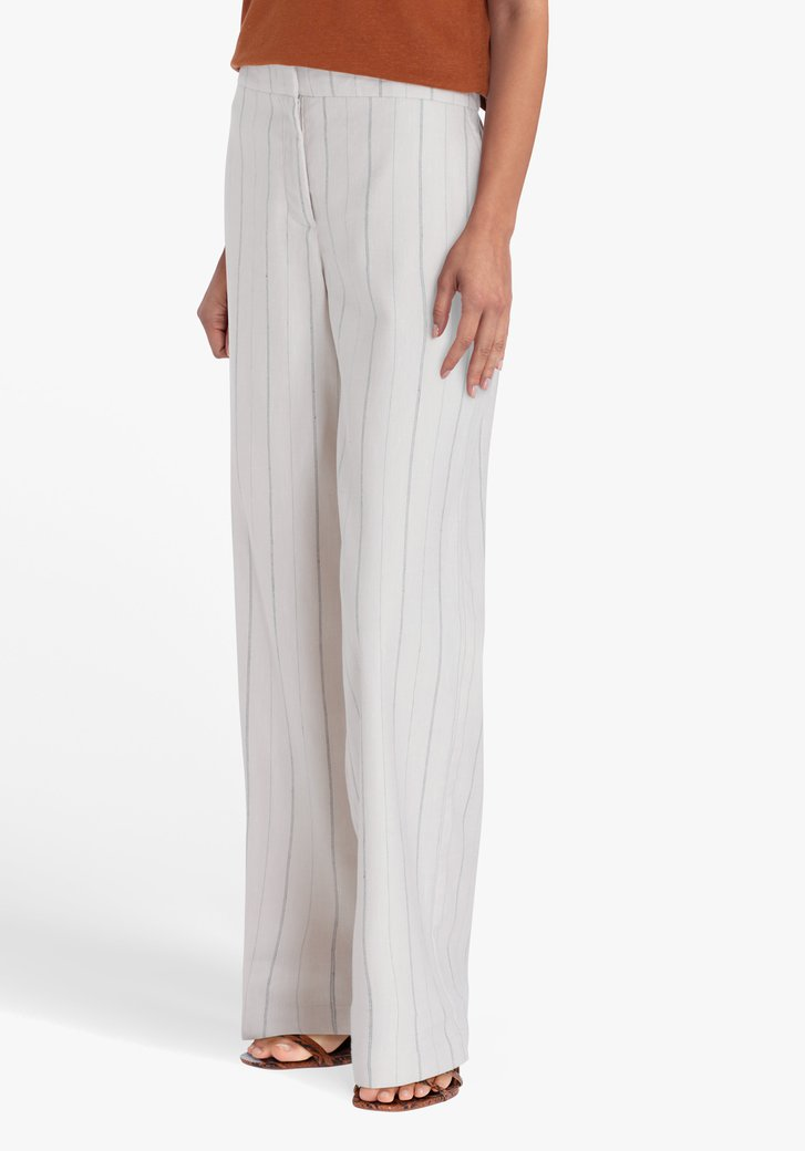 Pantalon large beige à rayures noires