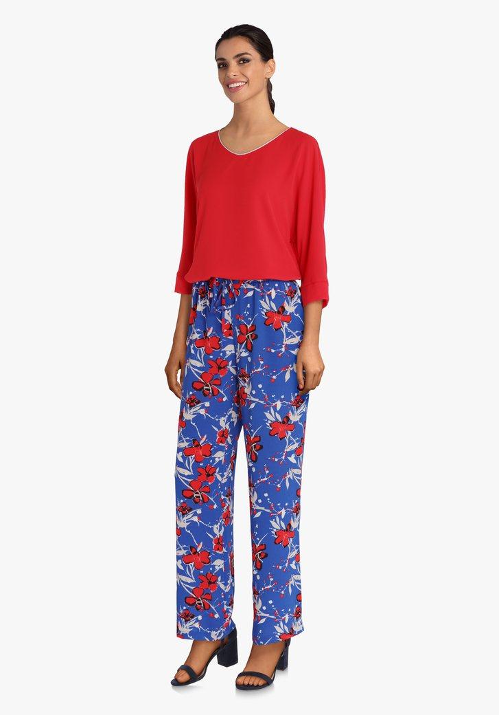 Pantalon palazzo bleu à fleurs rouges