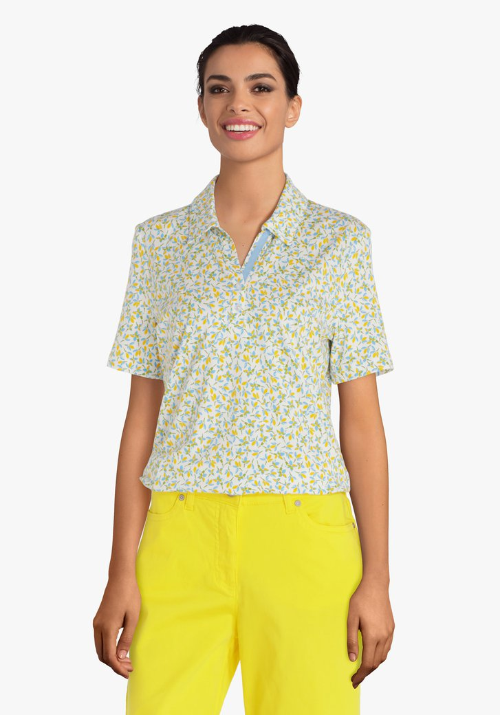 Polo vert à fleurs jaunes et bleues