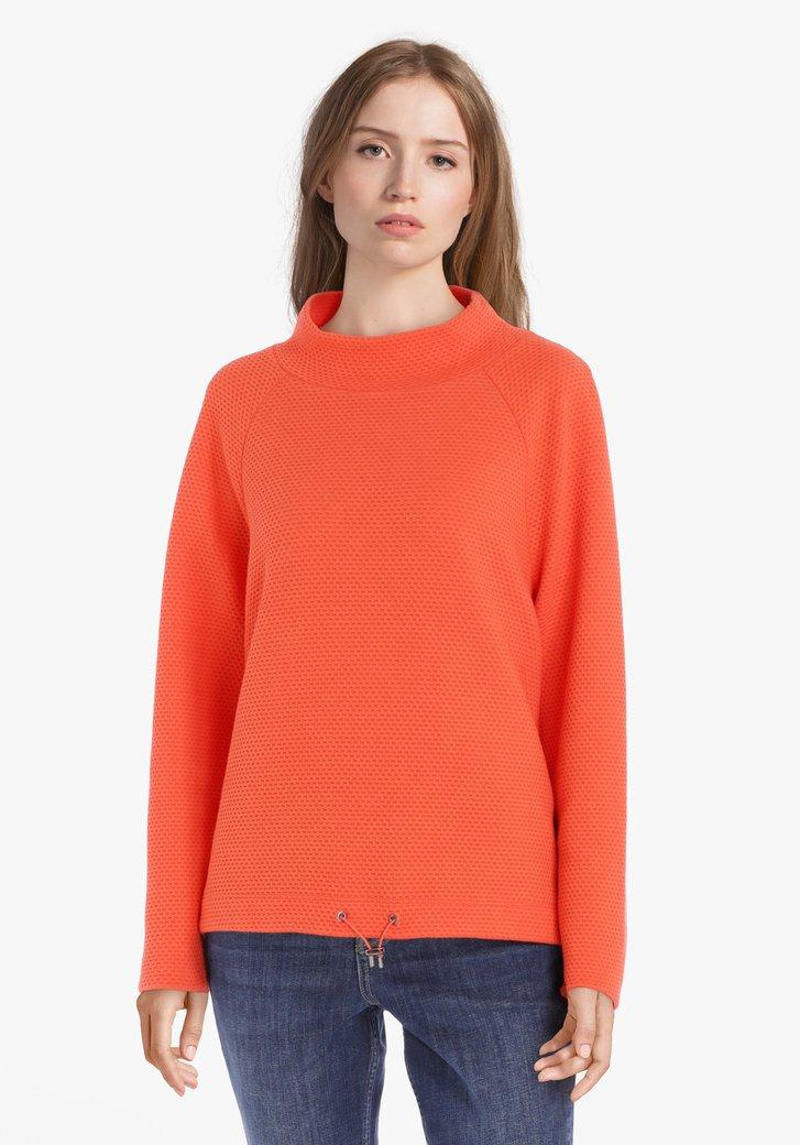 Pull orange en tissu doux texturé