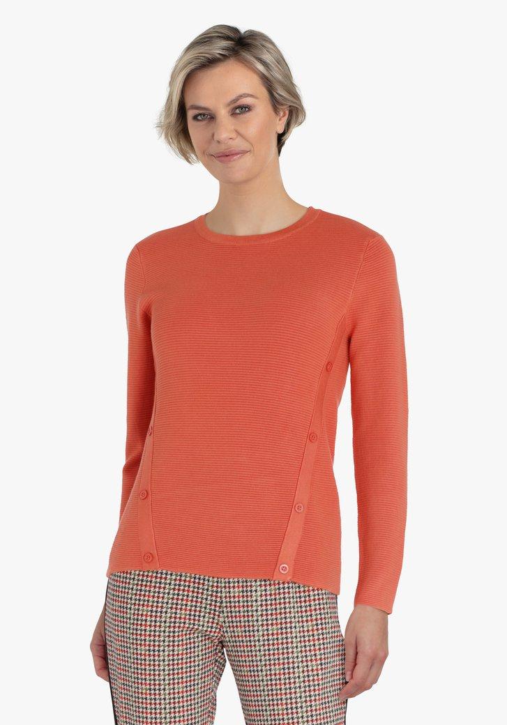 Pull orange en tissu texturé
