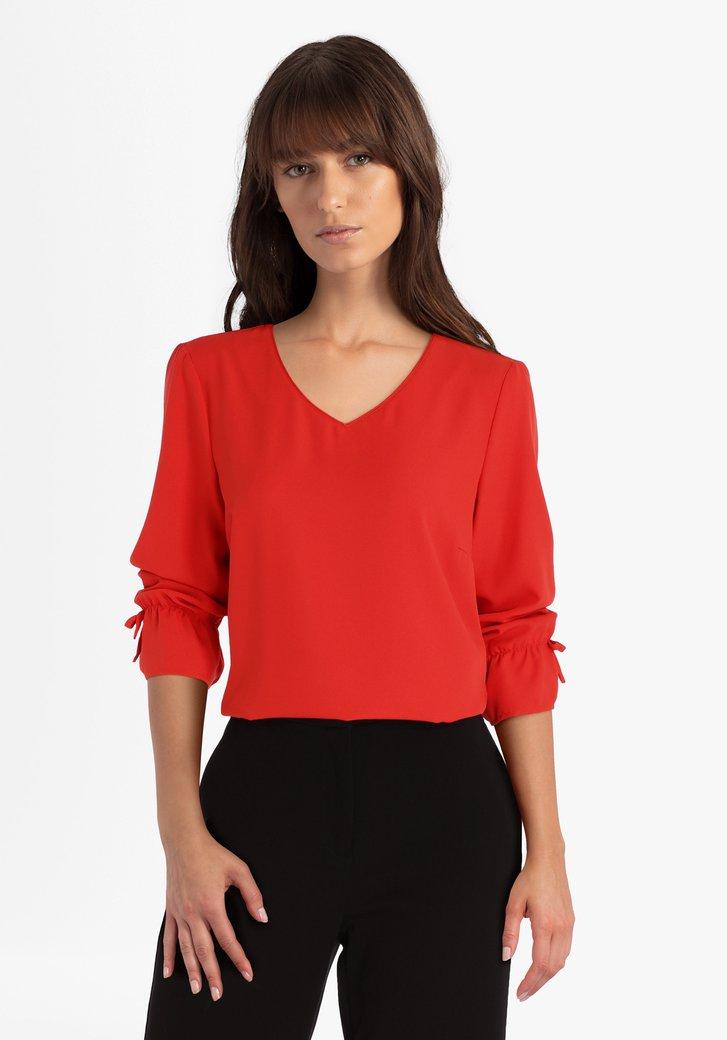 Rode blouse met strikjes