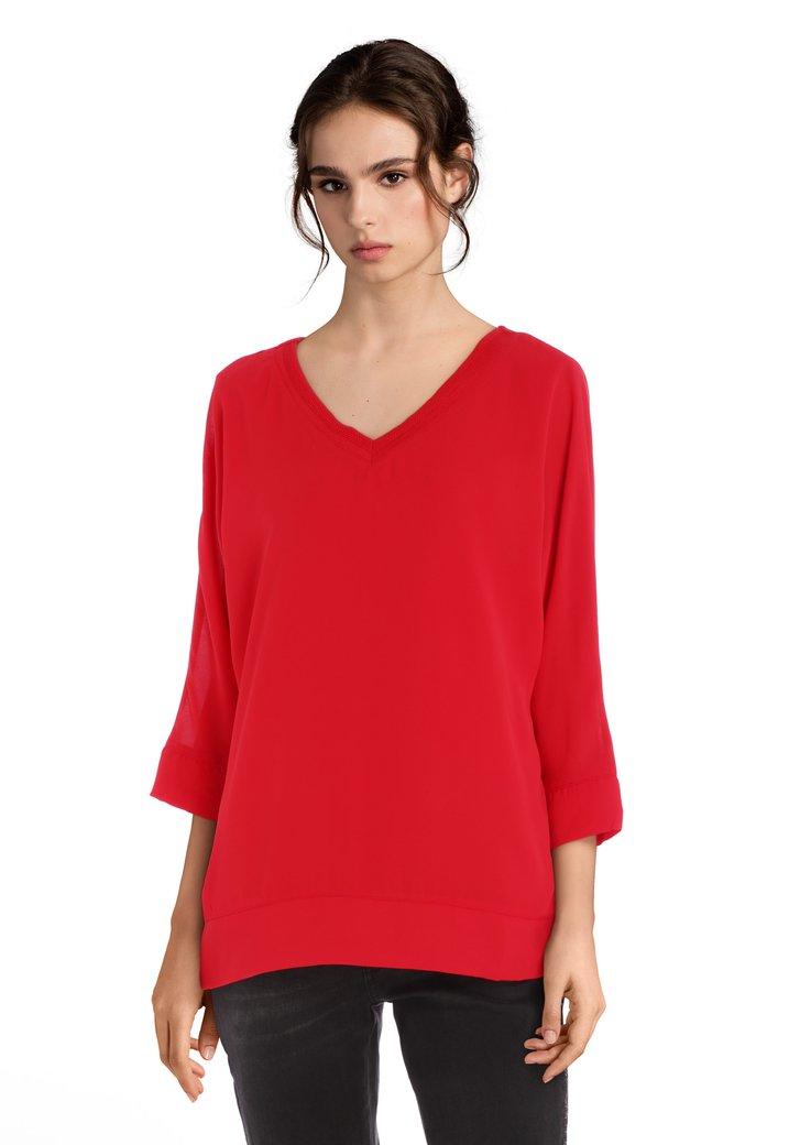 Rode blouse met V-hals in structuurstof
