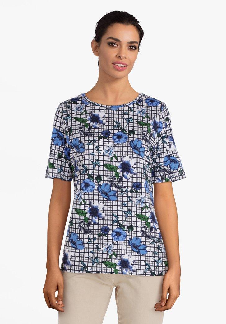 T-shirt blanc à carreaux avec des fleurs bleues