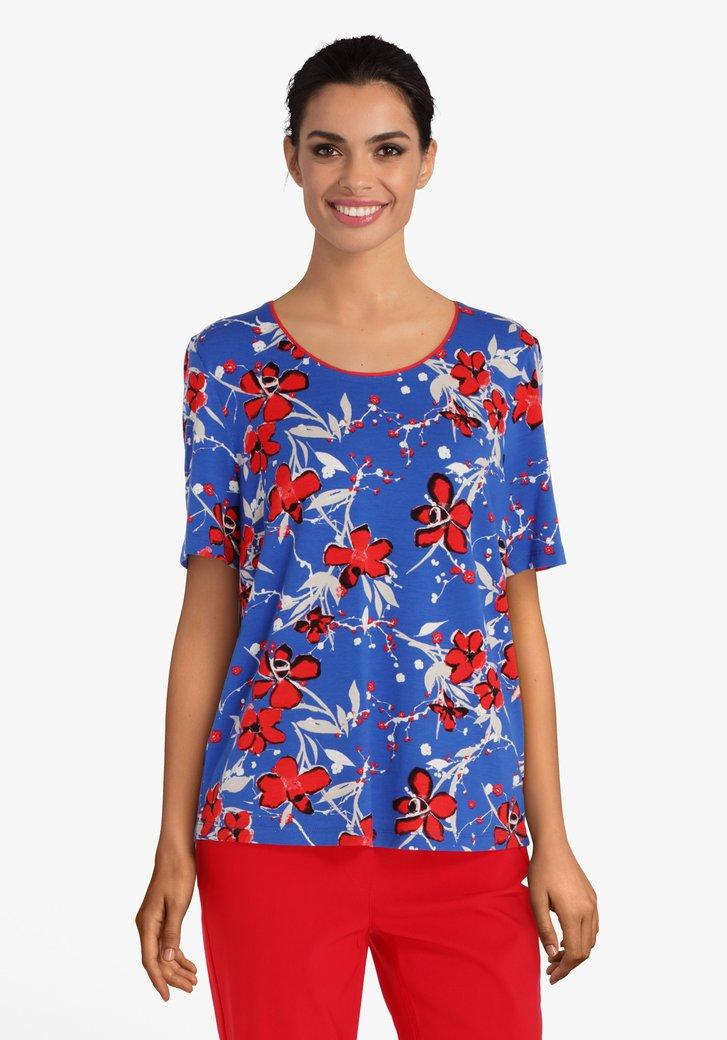 T-shirt bleu à fleurs rouges