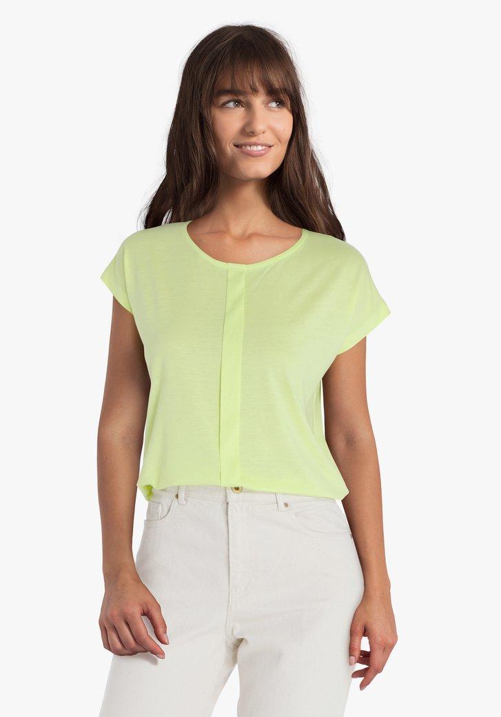 T-shirt jaune vert avec un détail vertical