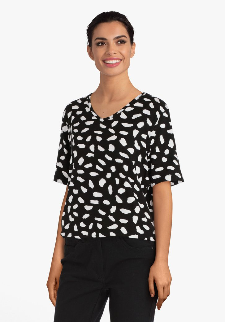 T-shirt noir à motif blanc