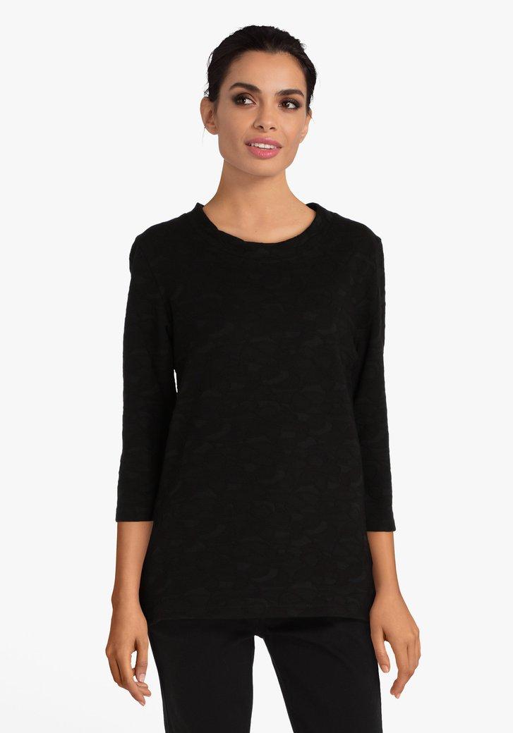 T-shirt noir avec motif en relief
