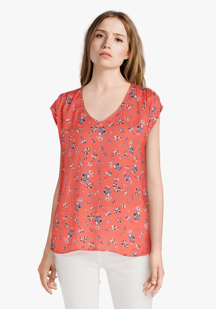 T-shirt orange à fleurs bleues