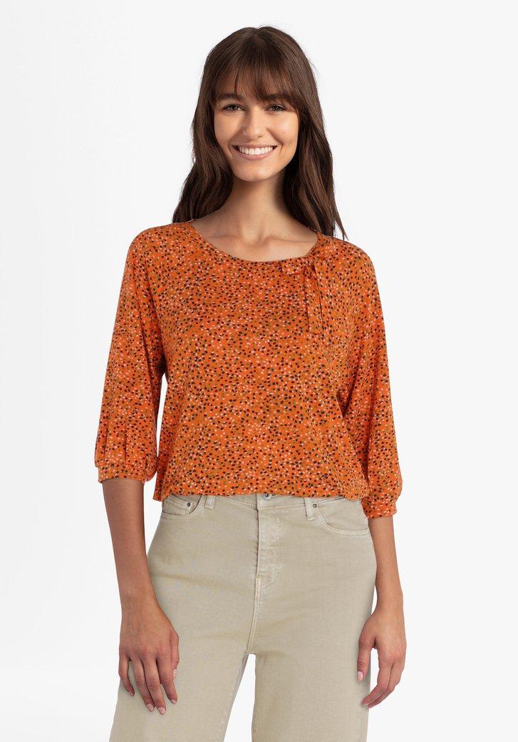 T-shirt orange à pois