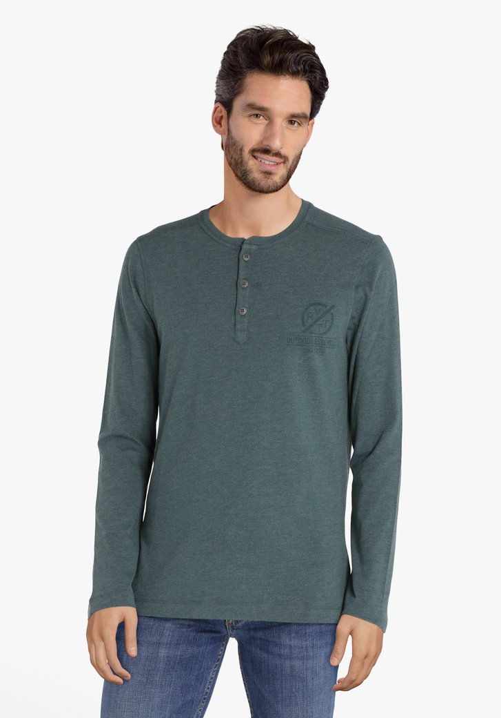 T-shirt vert à boutons argentés