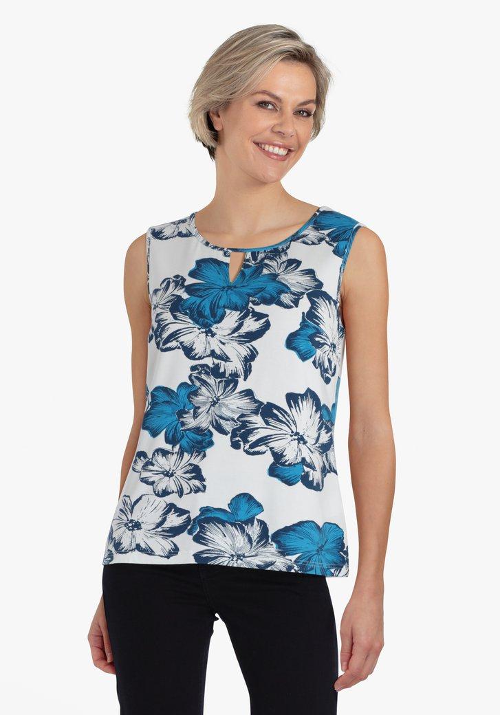 Top blanc avec imprimé floral bleu