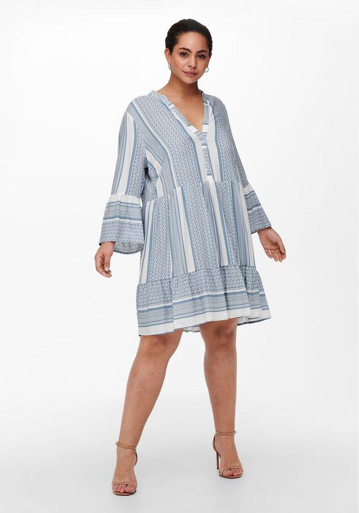 Wit kleed met blauwe print