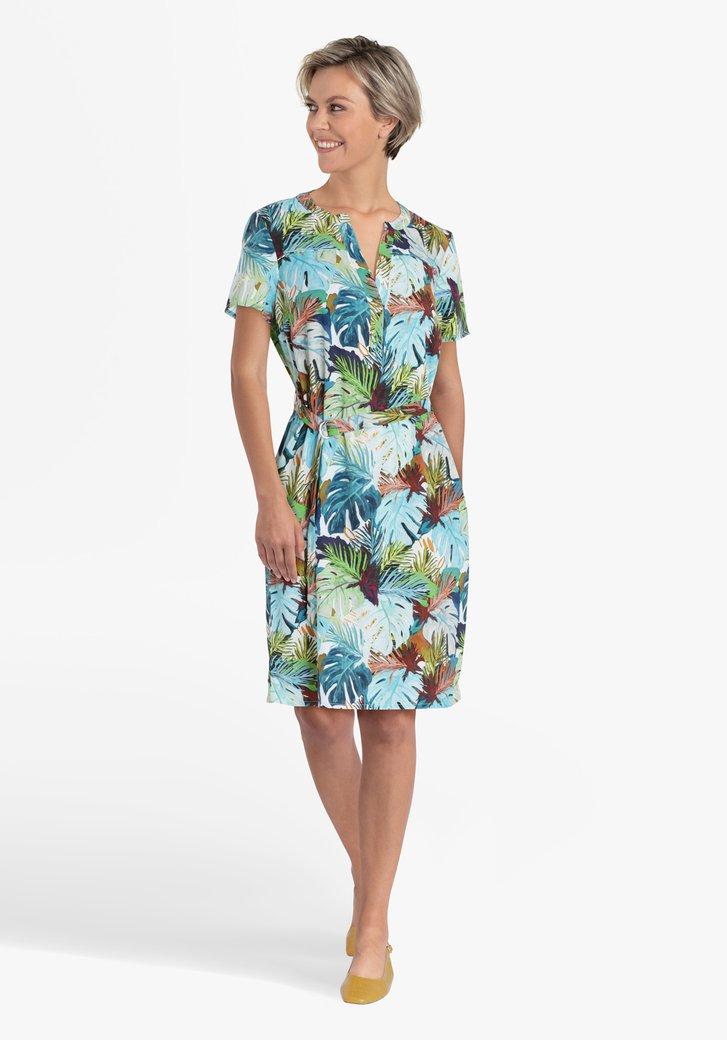 Wit kleed met tropische bladerprint