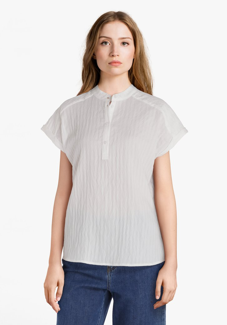 Witte blouse in structuurstof