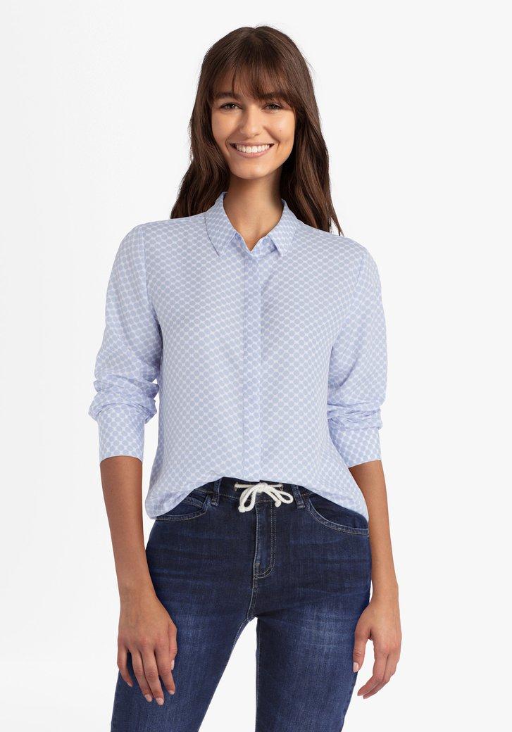 Witte blouse met blauwe bollen